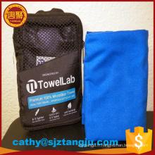 Chine fournisseur microfibre voyage / sport / camp / serviette avec poche à fermeture à glissière, sac à main en microfibre suède serviette