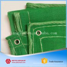 filet de sécurité de construction vert avec corde et oeillets