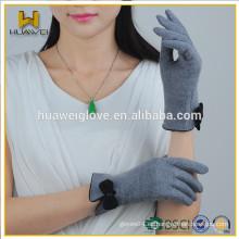 Los guantes suaves calientes más calientes de las lanas de las señoras del invierno del estilo superventas con el arco