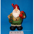 Santa Claus with Wreath and Gifts for Christmas Decoration