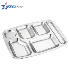 Student in school lunch using stainless steel food tray