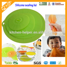 Un juego de tapas de silicona de 4 tapas / robo de la tapa hueco para herramientas de cocina