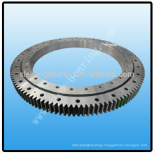 Slewing bearing with external gear for rotating machinery