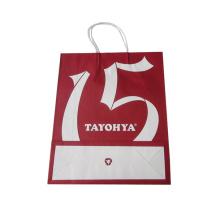 strenger Inspektionsprozess kleine bunte Geschenk braun Kraftpapier Einkaufstasche