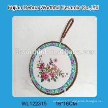 Porte-pot en céramique en forme de fleur avec corde brune