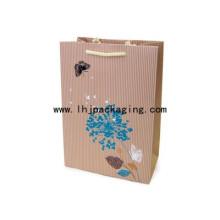 Bolso de papel personalizado con textura de relieve y mango de cuerda