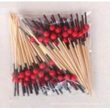 Cabeza negra con palo de bambú