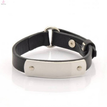 Bracelet fait sur commande de manchette de cuir de mot avec la plaque en métal gravée