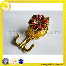 charming plastic or metal curtain holdbacks and hooks with blooming red flower