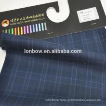 En stock tela sin cordones azul verdoso hecha de 50 lana y 50 poliéster peso 265g / m