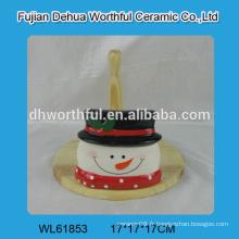 Porte-tissu en céramique en forme de bonhomme de neige avec partie en bois