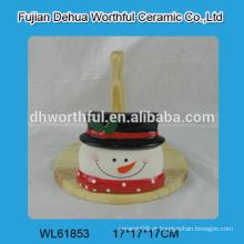 Suporte de tecido cerâmico em forma de boneco de neve com parte de madeira