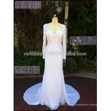 Glamours Mermaid Sweetheart vestido de noiva de renda de manga comprida Veja através de vestido de nádega com molho de renda branco Backless White Chiffon