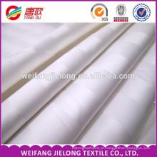O fornecedor chinês vendas por atacado penteava produtos originais do tecido da listra do cetim para vender o tecido 100% branco da listra do cetim do algodão