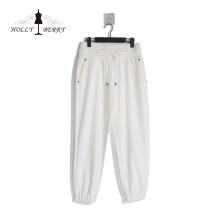 Atmungsaktive elastische Niete mit hoher Taille Lose Streetwear Weiße Damen Jogginghose Modisch
