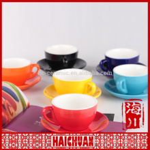 Colored cappucino cup and saucer set