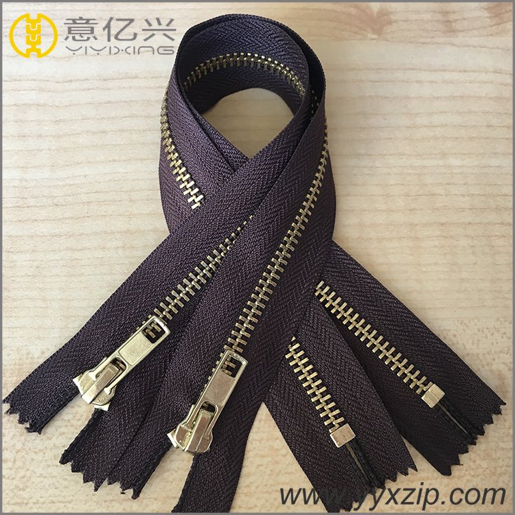 shiny gold metal zipper