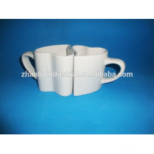 Tazas asombrosas del corazón en forma de pareja, taza de los pares de la porcelana con diseño del OEM