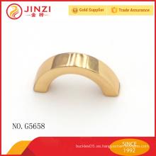 Decoración de oro ligero del metal de la forma del arco para los bolsos
