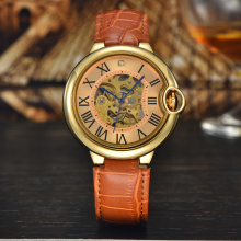 Orange leather band gold case skeleton watches