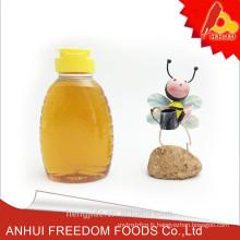 nous achetons du miel polyfloral naturel pur en gros dans la petite bouteille de 500g
