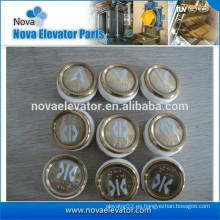 Botón pulsador dorado del color del elevador