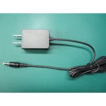 Montado en la pared nosotros Enchufe 6V1a (6V1000mA) Adaptador de corriente de conmutación de CA / CC