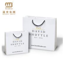 A cor feita sob encomenda luxuosa do boutique por atacado de alta qualidade imprimiu os sacos de retalho da compra do presente do papel com logotipo e punhos