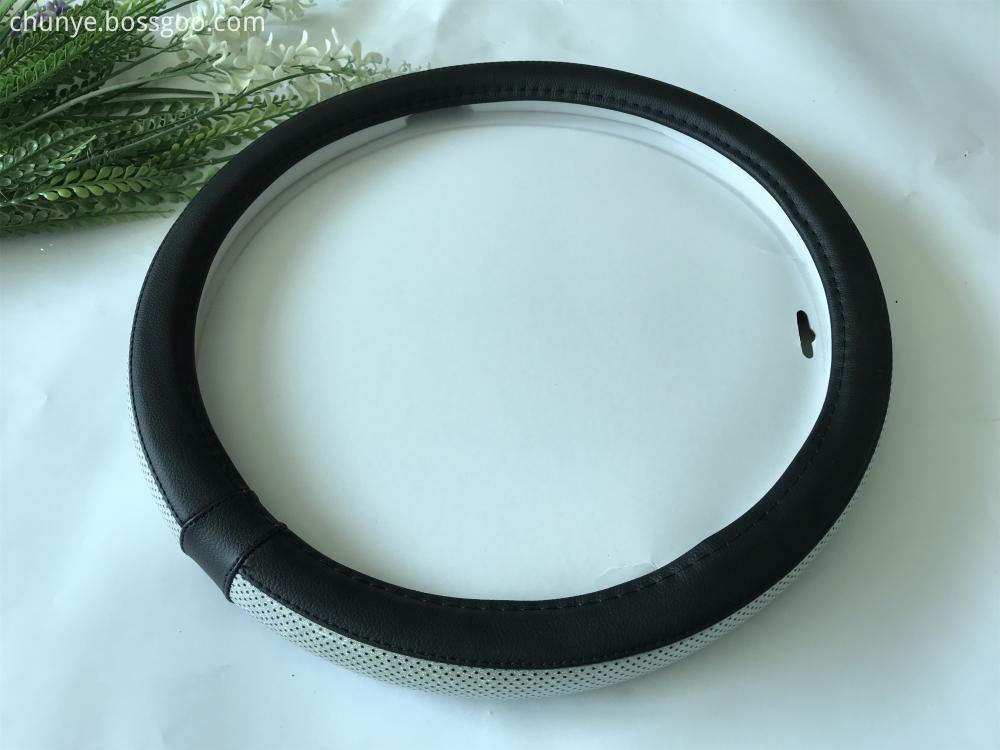 white and black steering wheel cover