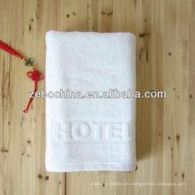 Insignia de encargo disponible toalla al por mayor del telar jacquar del hotel del algodón del 100 por ciento