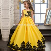Nuevo diseño clásico satén vestido de niña de color amarillo atado piso vestido de bola de satén niños niña vestido