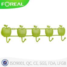 Elegante gancho de ropa montada en la pared de Apple forma