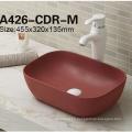 Lavabo de cerámica del precio bajo de China en fregadero del cuarto de baño