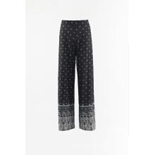 Pantalones sueltos de tela de rayón estampados.
