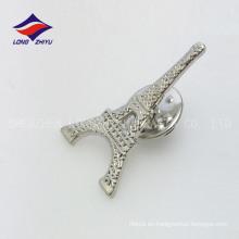 El metal elegante que ahueca la insignia de la torre de la plata de la mariposa