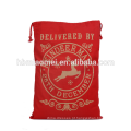 Saco do presente do Natal dos sacos da meia do cordão da cor vermelha do Xmas do divertimento
