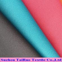 Tissu doux de microfibre de peau de pêche de polyester de 100% pour des vêtements