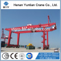 Container spreader, container stacking crane, container lifting cranes