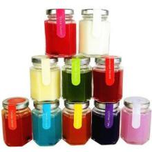 colorful scented soy candles in hexagonal glass