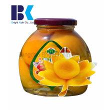 Garrafas de vidro, conservas de pêssego amarelo em calda
