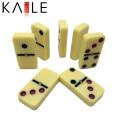 Kaile Factory domino de couleur ivoire avec boîte en fer blanc