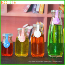 Venta al por mayor de 100 ml a 250 ml botellas de vidrio de bebidas con botella de leche de plástico