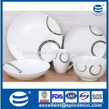 Vajilla de cerámica de forma redonda con platos y tazones