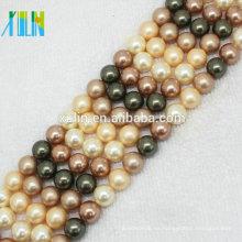 Venta al por mayor de 6 mm de color natural akoya perlas de concha de perlas de concha de agua dulce para perlas