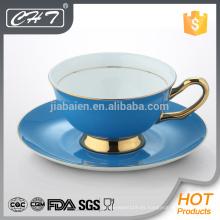 Taza de té de China de hueso de la multa del color del nuevo producto de la venta caliente y sistema del platillo