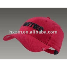 Red baseball cap with embroidered letter in front panel