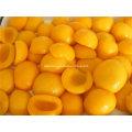 2016 Colheita de pêssegos amarelos enlatados Metades