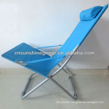 Outdoor lounge chair with pillow.
