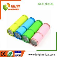 Fábrica Venta al por mayor 3 * AAA Batería Powered promocional brillante bolsillo colorido 9 llevó brillo en la antorcha linterna oscura