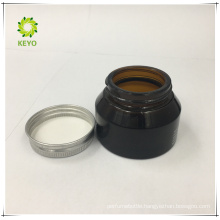 Black aluminium cosmetic jar amber glass with metal lid
